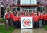 Group pictures of Seattle City Year corps members in front of Comcast HQ in Lynnwood, WA