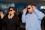 Miss Seattle and store manager wear 3D glasses