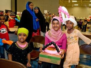 children with computer they won through an Internet Essentials event