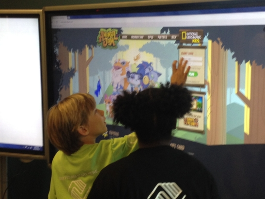 youth playing with a smart panel at the Bremerton Teen Center