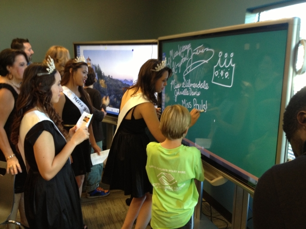 teens using smart board as a chalkboard