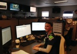 Jennifer Wolever sitting at her desk at the Everett XOC