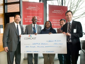 L to R Seattle City Councilmember Bruce Harrell, Markee Foster and B.G. Nabors-Glass with Goodwill, State Sen. Bob Hasegawa and Comcast VP Steve Kipp present Goodwill with $100,000