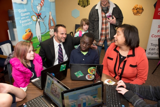 Comcast Director of Government Affairs Hans Hechtman, left, and Tacoma Urban League CEO Victoria Woodards, right, get an impromptu tech demo from a McCarver Elementary student who has been participating in KBTC youth camps and who was at our news announcement this week at the Foundatoin for Tacoma Students offices. For more information about the Internet Essentials Gold Medal Awards in Tacoma, please click on the picture.