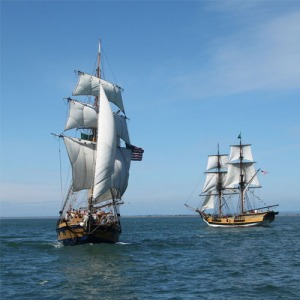 2 tall ships in the water
