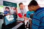 Comcast's Terry Davis explained the internet Essentials program at the Highline Schools back-to-school fair in SeaTac.