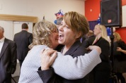 The military community is a tight-knit community: here's a hug for a visitor from Philadelphia, retired Brigadier General Carol Eggert, now Comcast's Vice President of Military and Veteran Affairs.