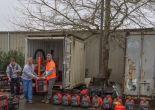 crew moving a generator